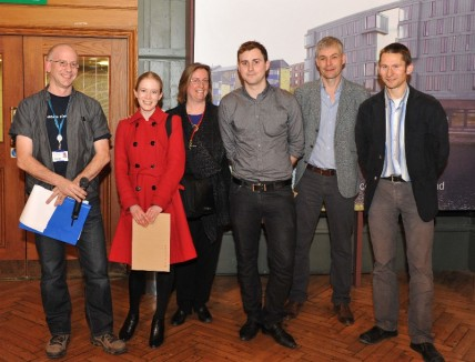 Nicky Willis (centre) wins best talk at the annual postgraduate research symposium